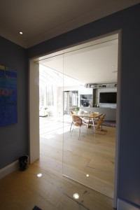 Frameless internal sliding pocket door