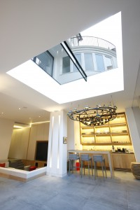 Frameless sliding rooflight
