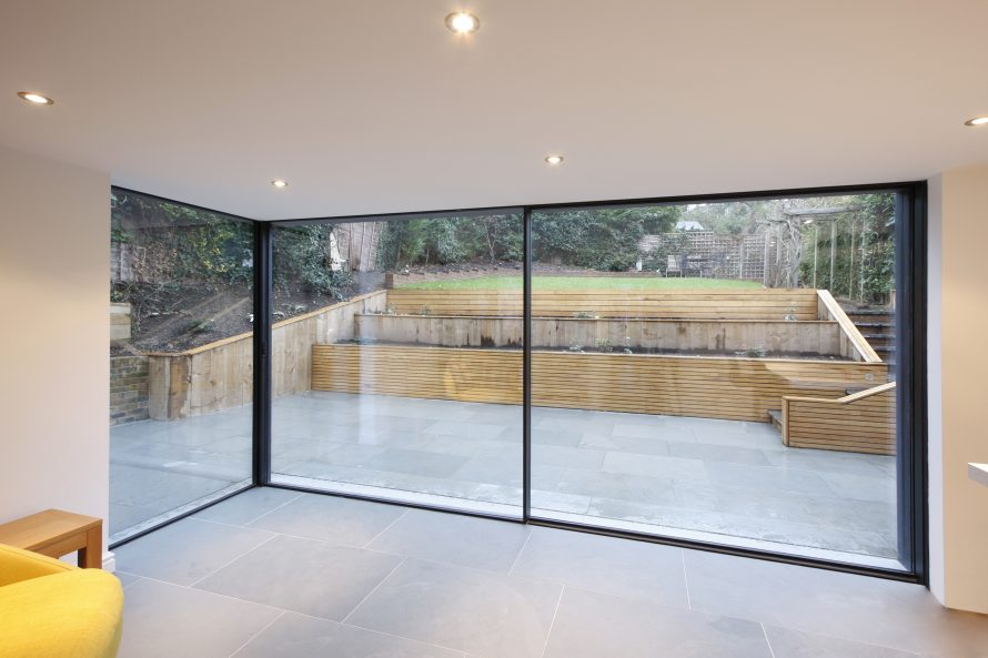 Slim framed sliding doors to residential refurbishment for Large glass wall