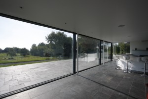 In this large extension in Wocestershire, near frameless sliding doors do not interrupt views across the large gardens
