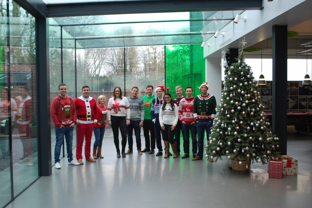 IQ Glass sales team pose in their Christmas Jumpers
