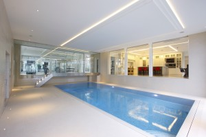 Frameless glass walkway and fire rated glass overlooking the pool at Totteridge Common