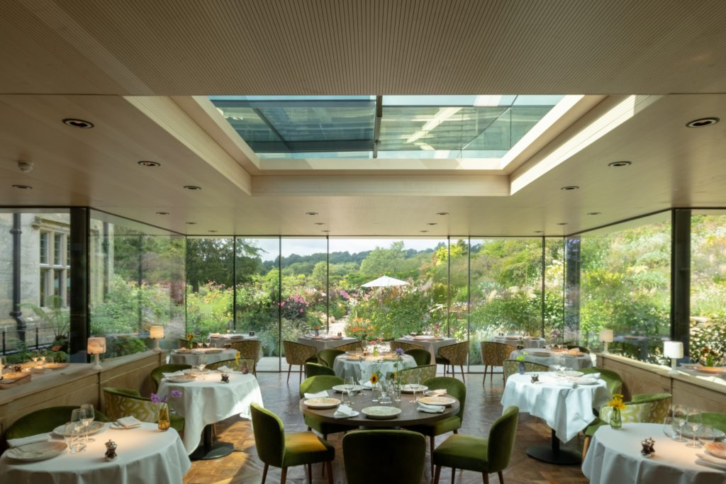 Large automated sliding rooflight in restaurant setting