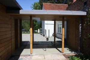 Glass, timber and zinc link to grade II listed home