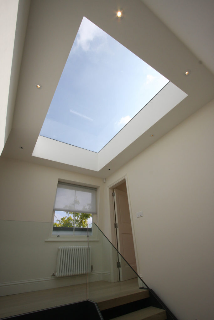 large frameless rooflight over the stairwell.