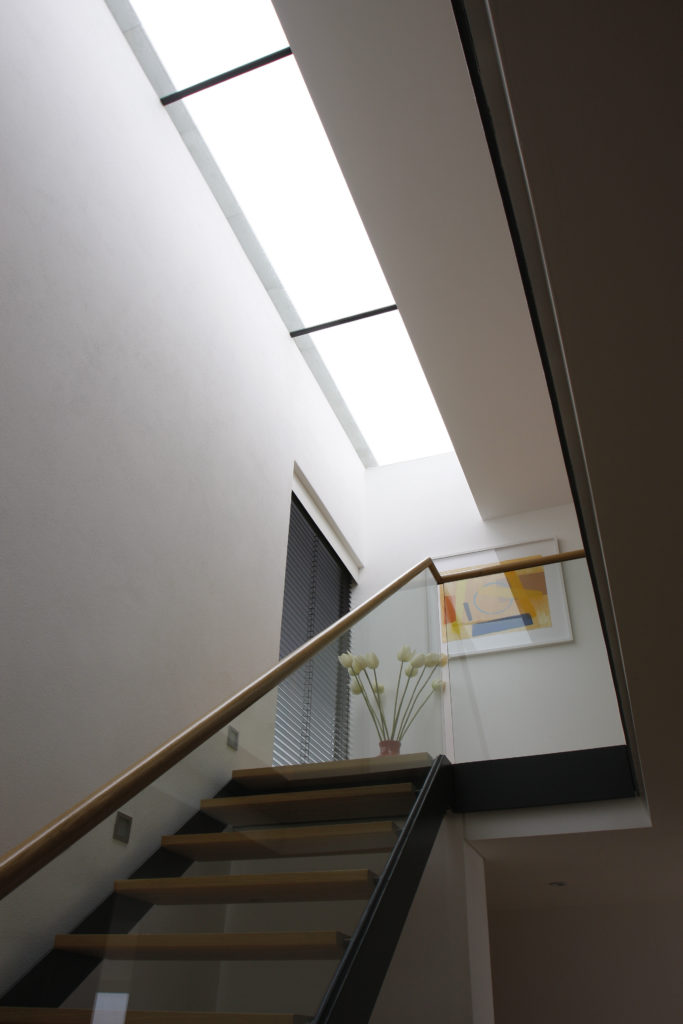 a strip rooflight over the staircase on this modern new build house.