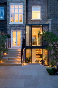 Photo Credit Seacon Ltd. Double height glass extension to Grade II* listed home in London