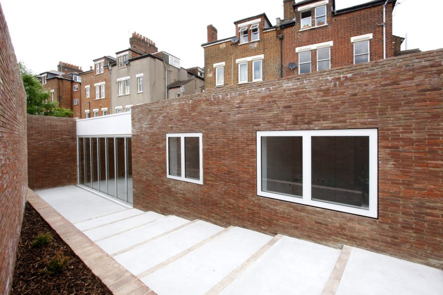 Spiral House featuring, flush glazed bi fold doors and Innovare windows with white frames