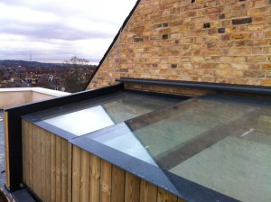 An automated sliding roof light was installed to allow easy access to a new roof terrace in North London