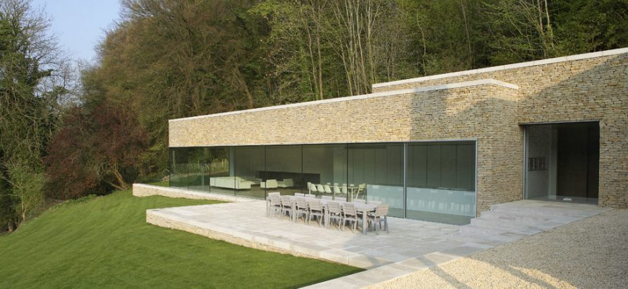 A wall of structural glass with a single sliding minimal window to the right.