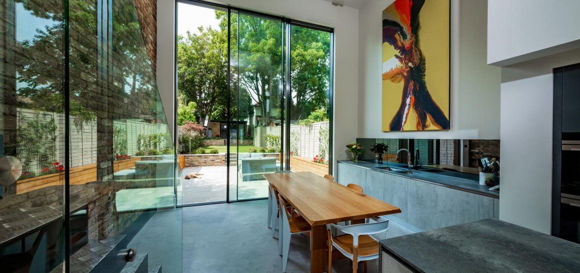4.5m tall sliding glass doors to kitchen extension