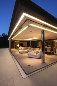 Automated glass doors create a floating roof design