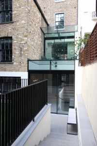 Warwick Gardens featuring slim frame sliding glass doors within a small side infill extension