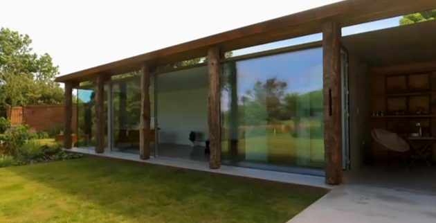 Large elevations of minimal glass sliding doors by IQ Glass.