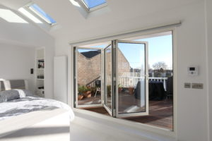 white framed bi folding doors to bedroom