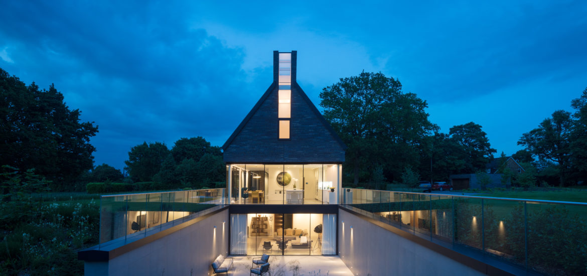 New build luxury home with minimal sliding glass facade