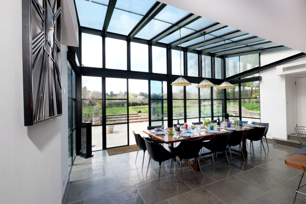 Glass walls and roof with structural minimal steel look beams