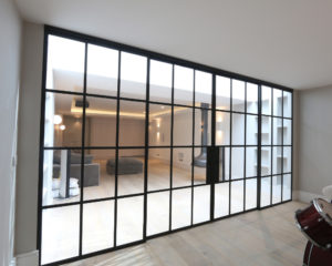 Contemporary broken plan living space featuring steel industrial style internal sliding doors