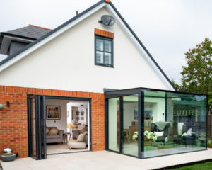slim framed glass box rear extension family home