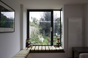 An opening aluminium window within an Oriel Window. Lowether Road.