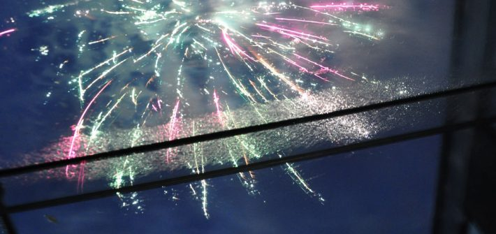 view of fireworks through structural glass roof at the IQ Glass showroom in Amersham