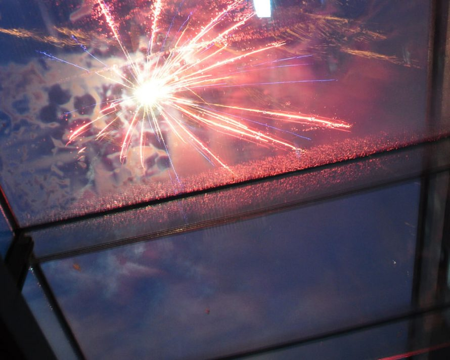 fireworks display at the IQ Glass showroom, photo taken through structural glass roof