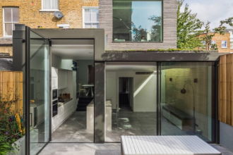 rear extension with large elevations of architectural glass