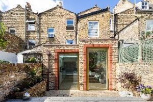 Terraced Victorian house with back extension featuring a glass pivot door