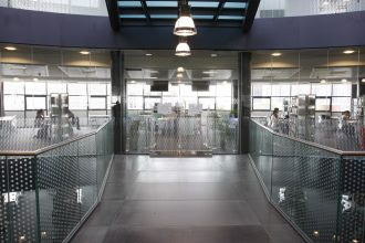 Sandblasted structural glass balustrades inside Croydon college