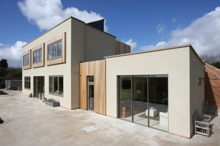 Contemporary new build home with sliding glass doors and privacy glass