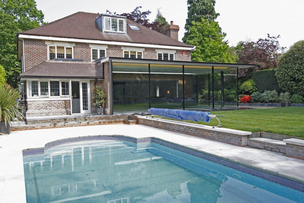 outdoor pool and glass extension in london