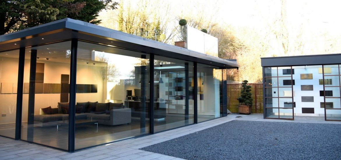 IQ showroom with sliding glass doors and a frameless glass balustrade