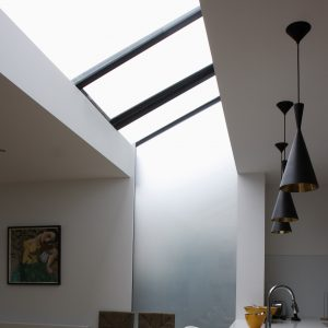 Minimal automated venting rooflight to modern kitchen