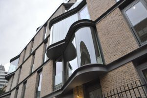 Structural glass curved windows
