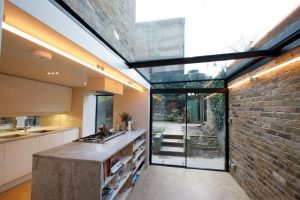 Side infill extension to create modrn kitchen with sliding doors and rooflight