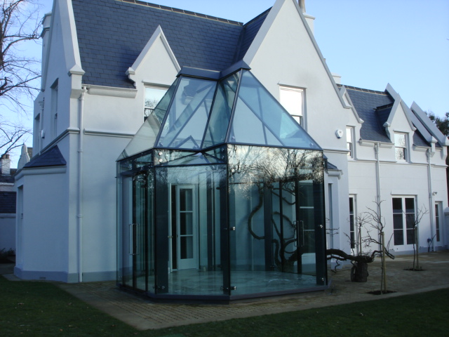 Mill Hill frameless glass bespoke shaped conservatory