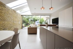 Strip rooflight and slim sliding patio doors to modern rear renovation