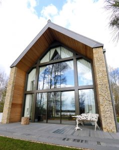 Structural glass facade to lake district home