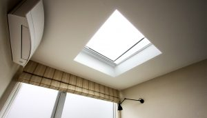 Minimal frameless effect electric venting rooflight