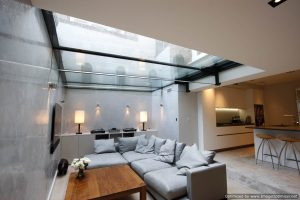 Slim framed structural glass roof to basement renovation