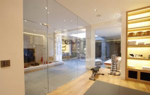 Modern basement extension with frameless internal glass doors and rooflight