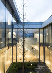Large structural glass facade to Swiss new build glazed home