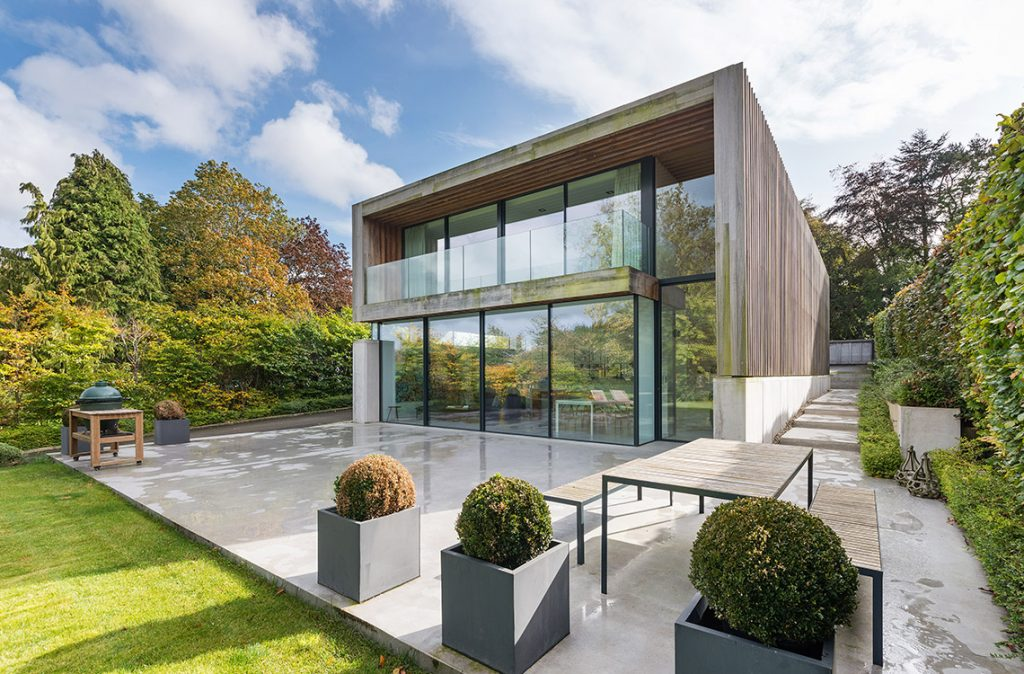 modern house design with large glass walls newcastle