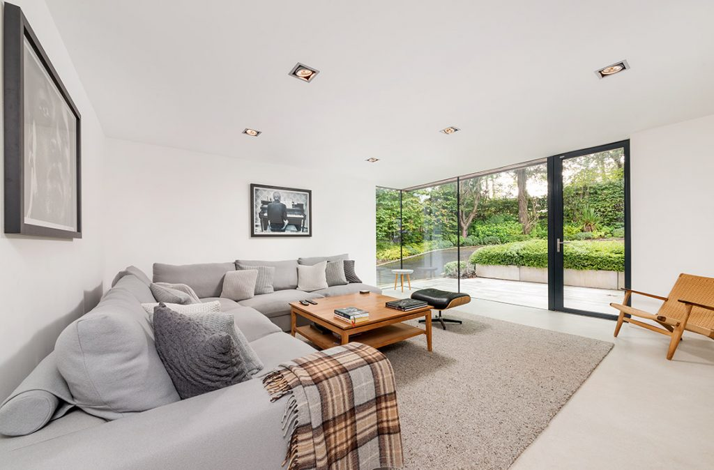 cosy living room with large glass wall and door