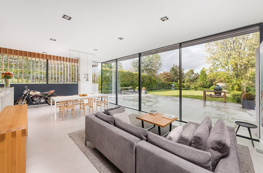 modern living room with large sliding glass doors newcastle