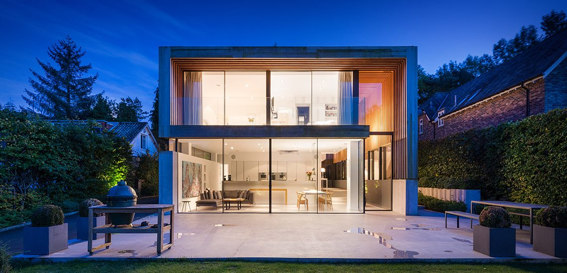 modern house in newscastle with large glazing at night
