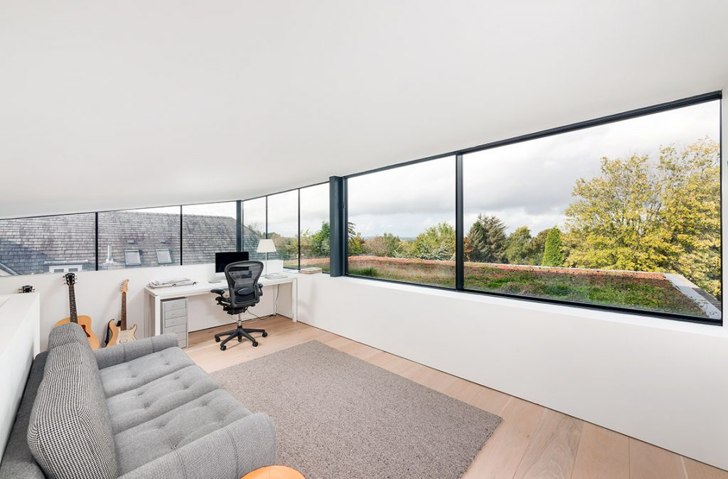 upper floor home office with large panoramic windows