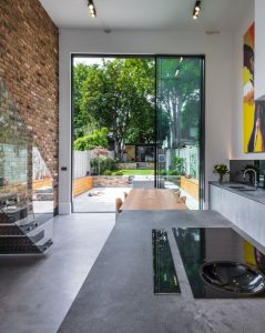 Double height sliding glass doors to rear elevation