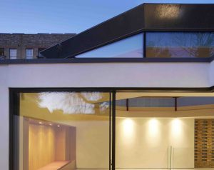 Ecclectic London home design with slim sliding doors and clerestory windows