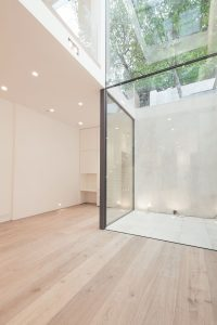 light filled home office frameless structural glass wall with ballustrades